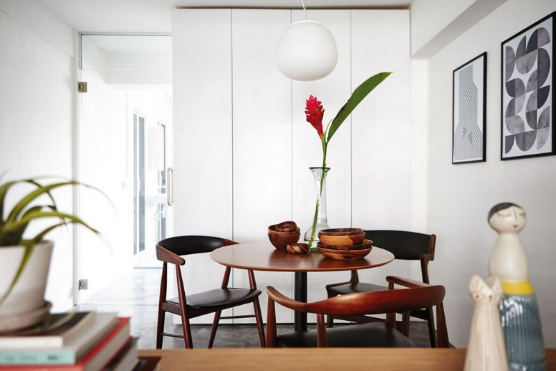 A trio of vintage Danish teak armchairs from us sitting alongside modern pieces.