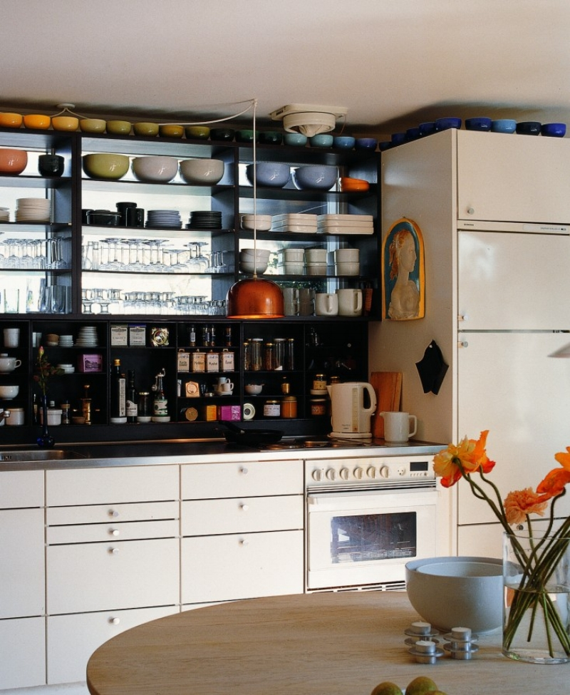 Grethe Meyer's kitchen cabinet system designed and built in the 1960's is a familiar sight in most modern day kitchens today. Her colorful ceramics are displayed here on the open shelves.