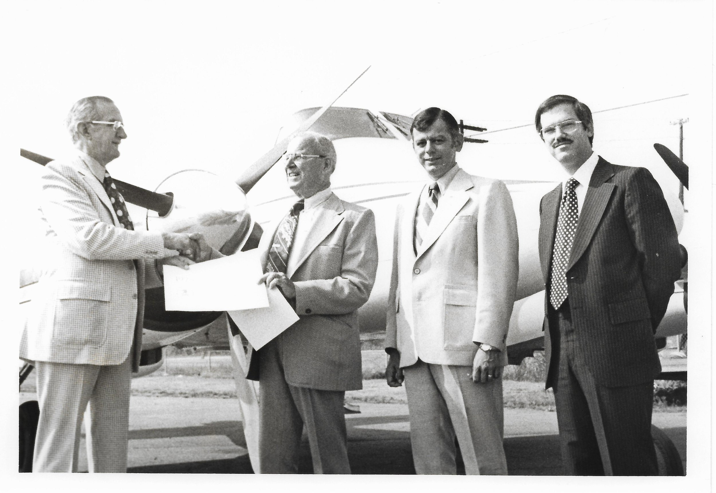 Claud Receives Award with Don and Dick.jpg