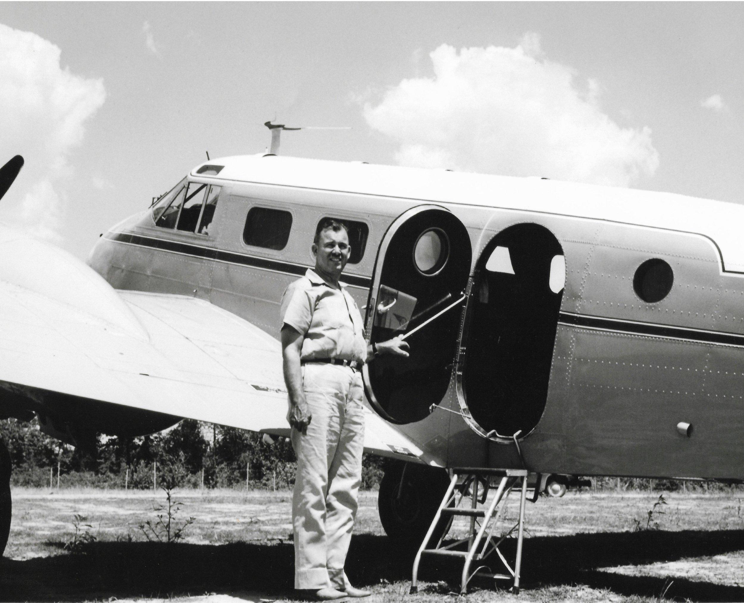 Claud Holbert beside aircraft.jpg