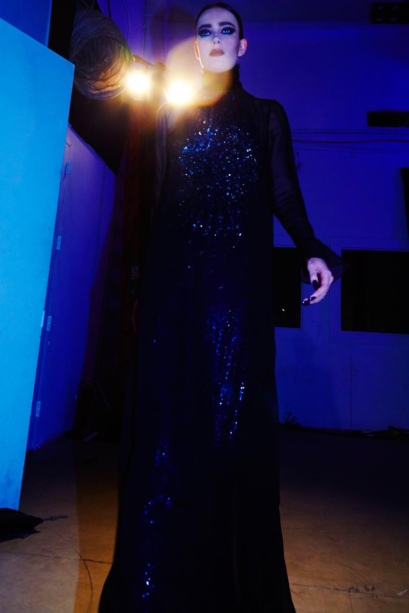 Model walks backstage at Georgine
