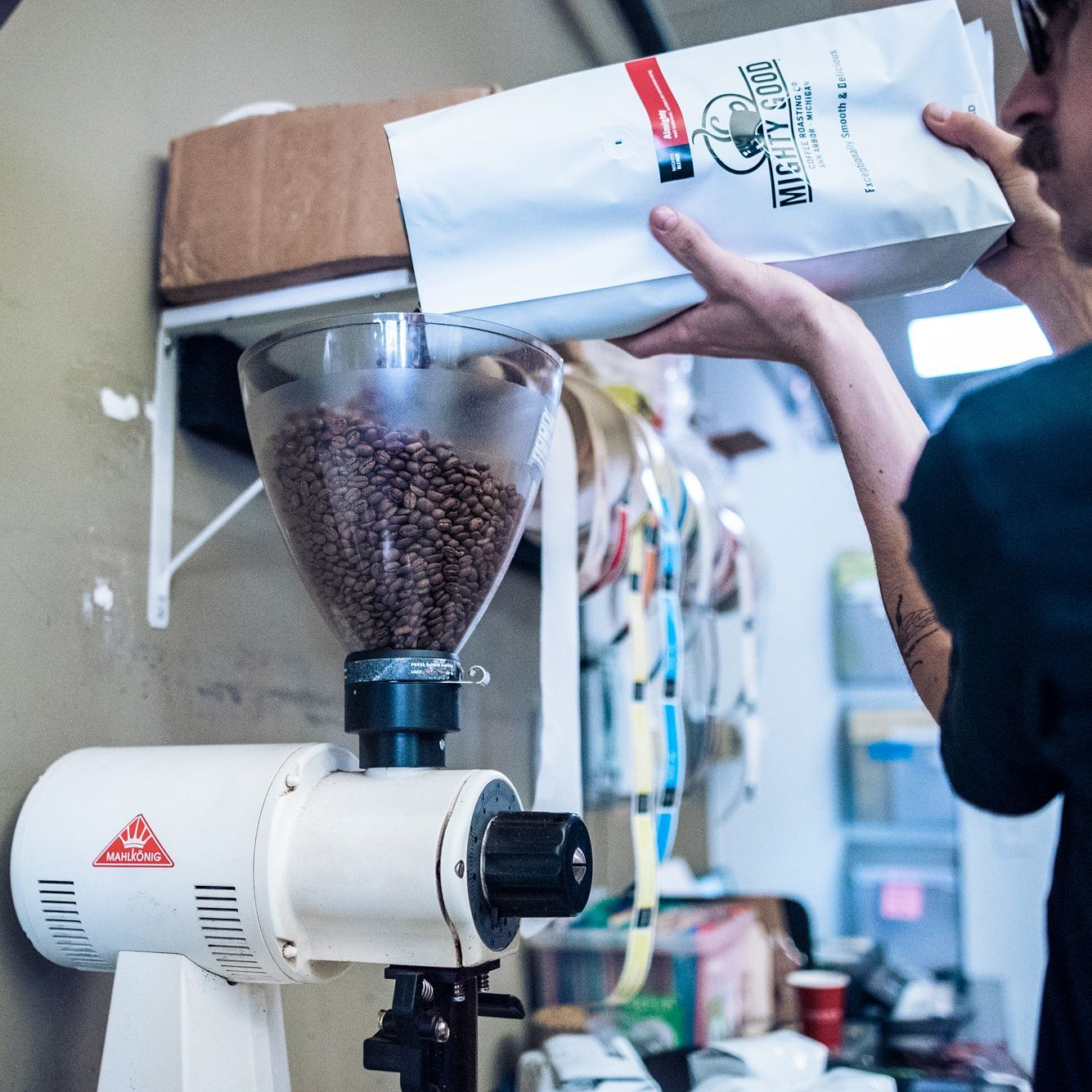 Grinding coffee at the roastery