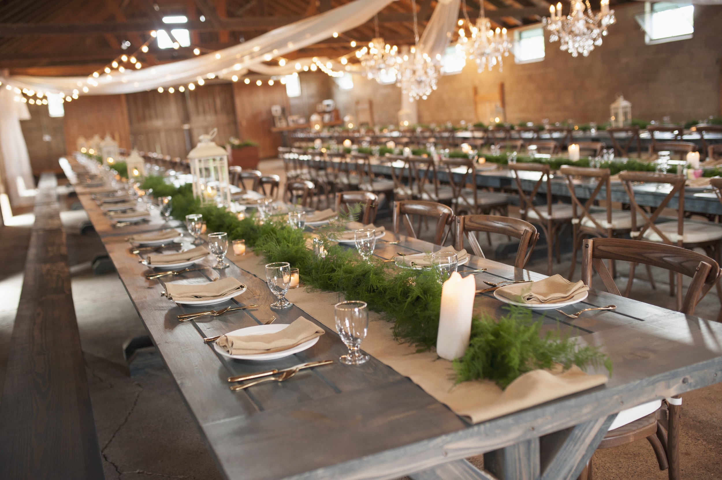 The Blue Barn at Lake Max Meadows accommodates up to 200 seated guest, providing ample space with rustic details of the barn preserved.
