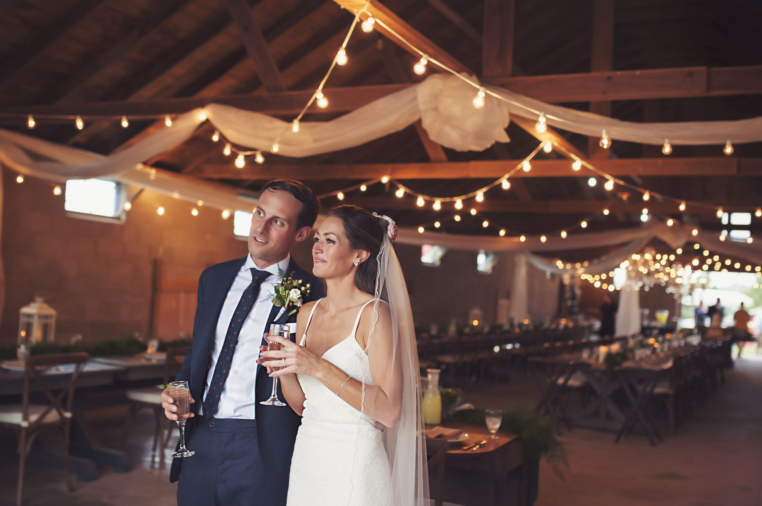 The Reception - Accommodating up to 200 seated guest, the barn provides ample space with rustic details preserved.