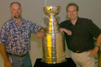 Mike Stephenson, right, managed coverage of the Tampa Bay Lightning's Stanley Cup championship in 2004. He and sports editor  Jack Sheppard  pose with the trophy.