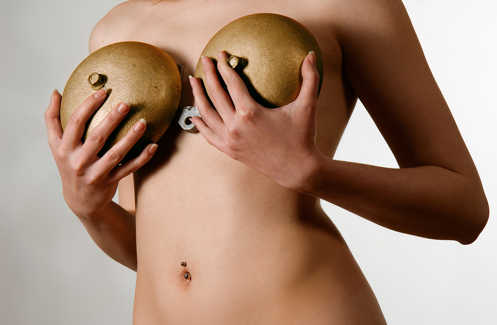 bigstock-Beautiful-woman-holding-golden-17553356.jpg