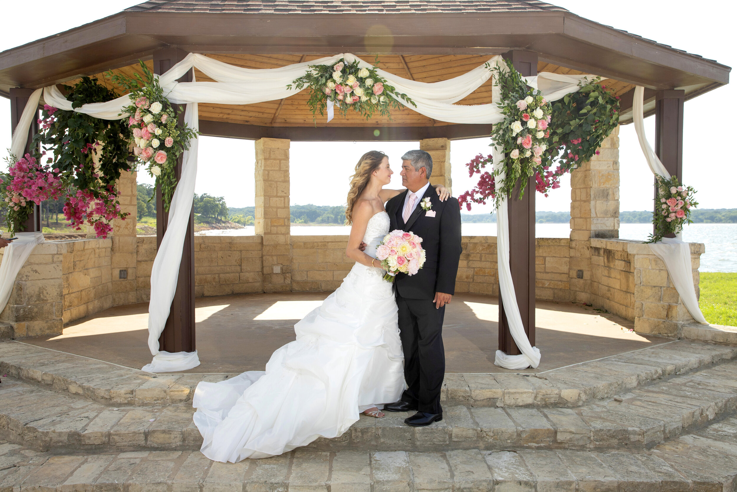 Alexis and Michael at paradise Cove on Lake Grapevine, still an awesome venue right on the lake!!