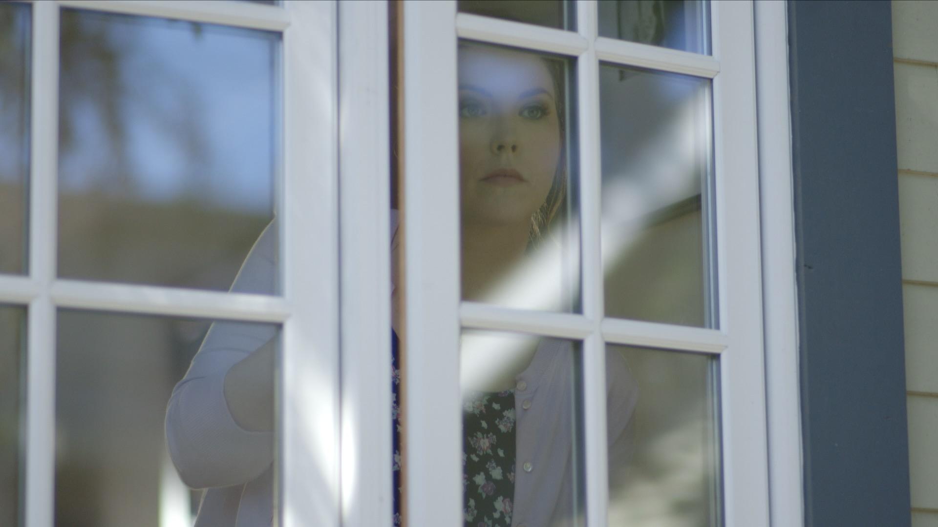 Melanie in window.jpg