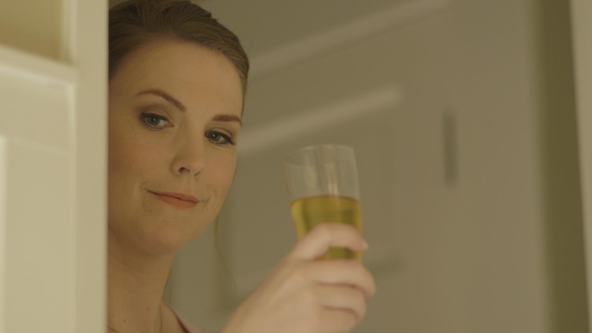 screen grab (champagne glass in door).jpg