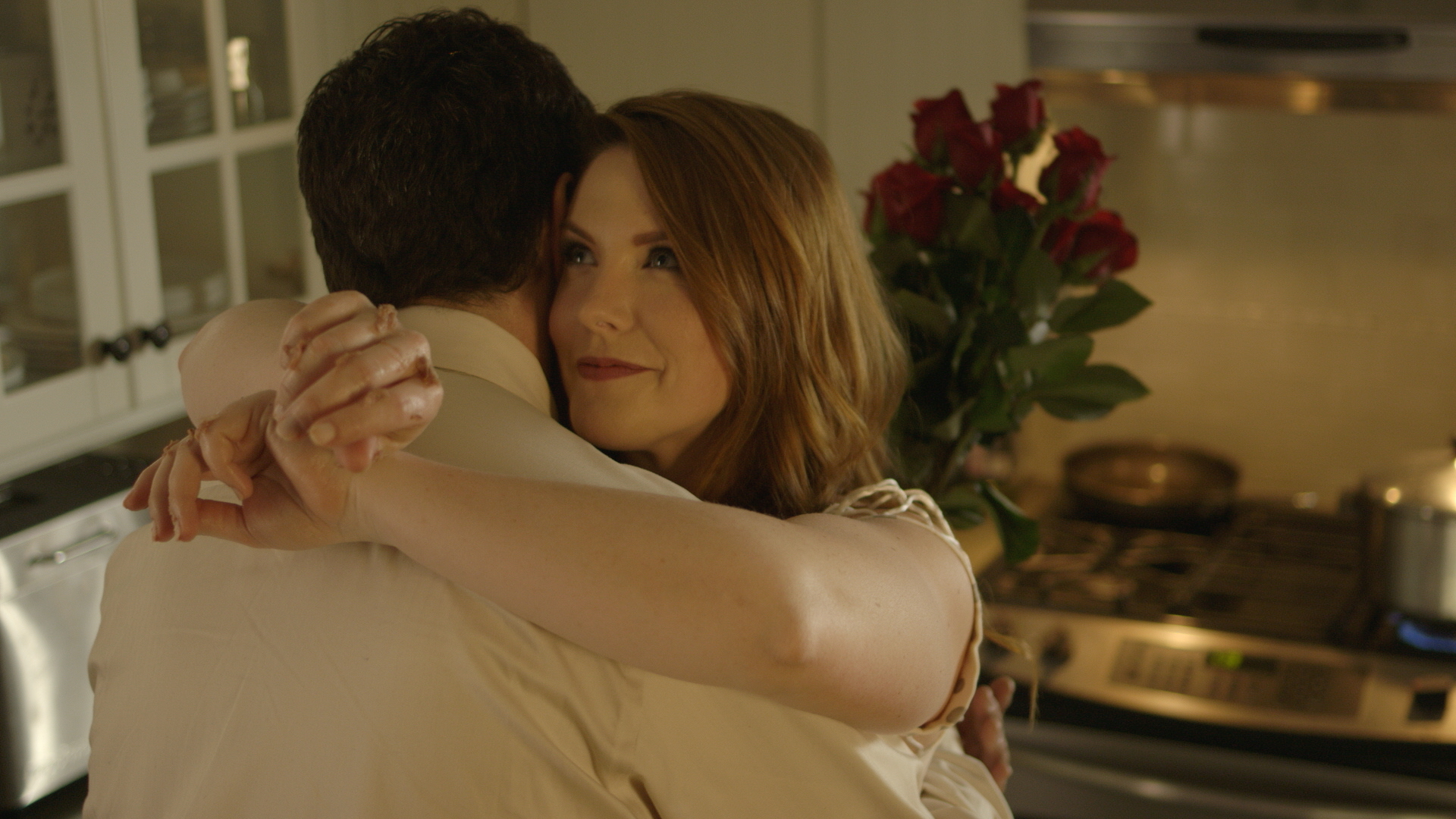 screen grab (kitchen hug).jpg