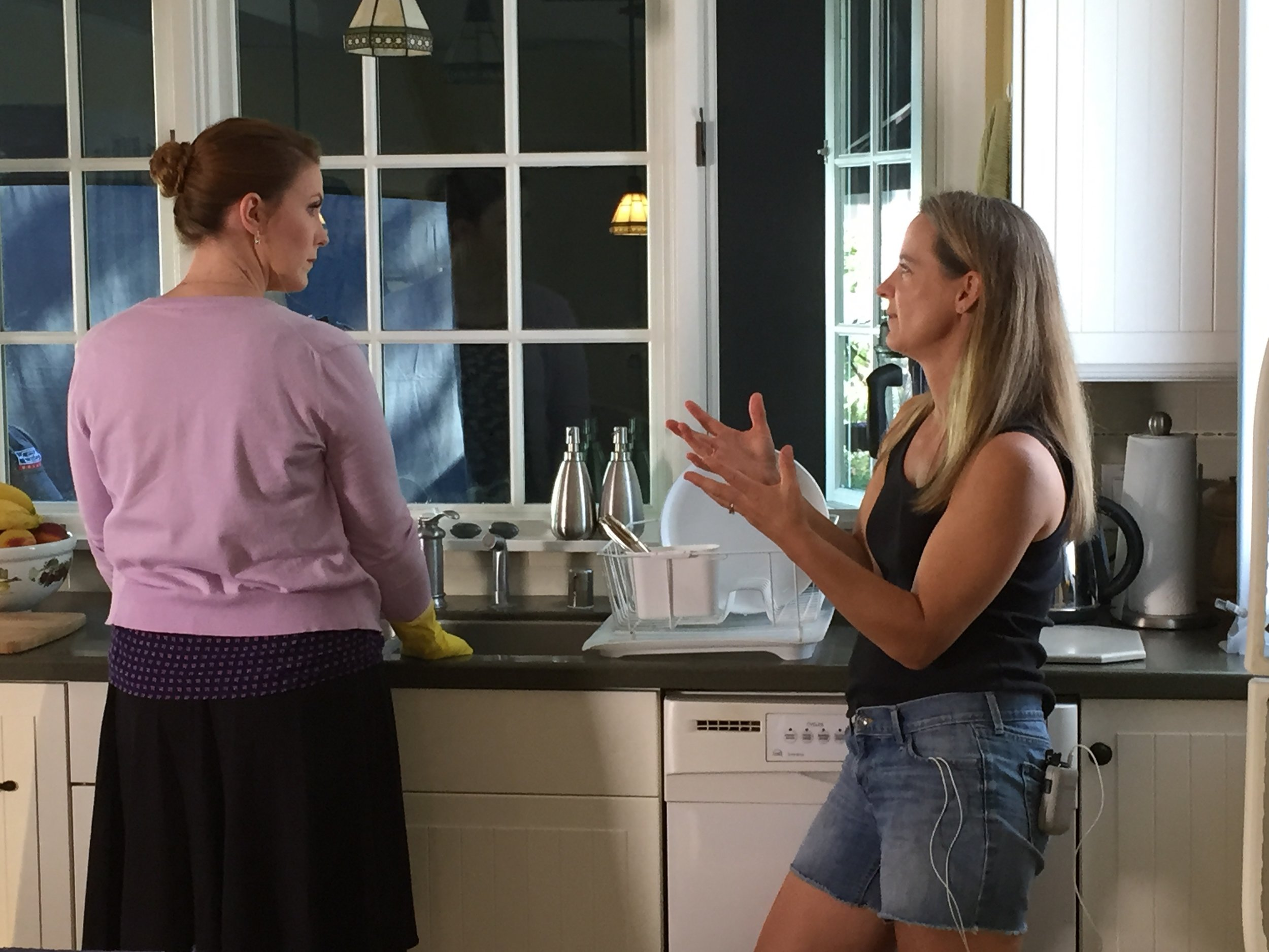 Lead actress Caitlin Brandes and Director Monika on the set of WINK