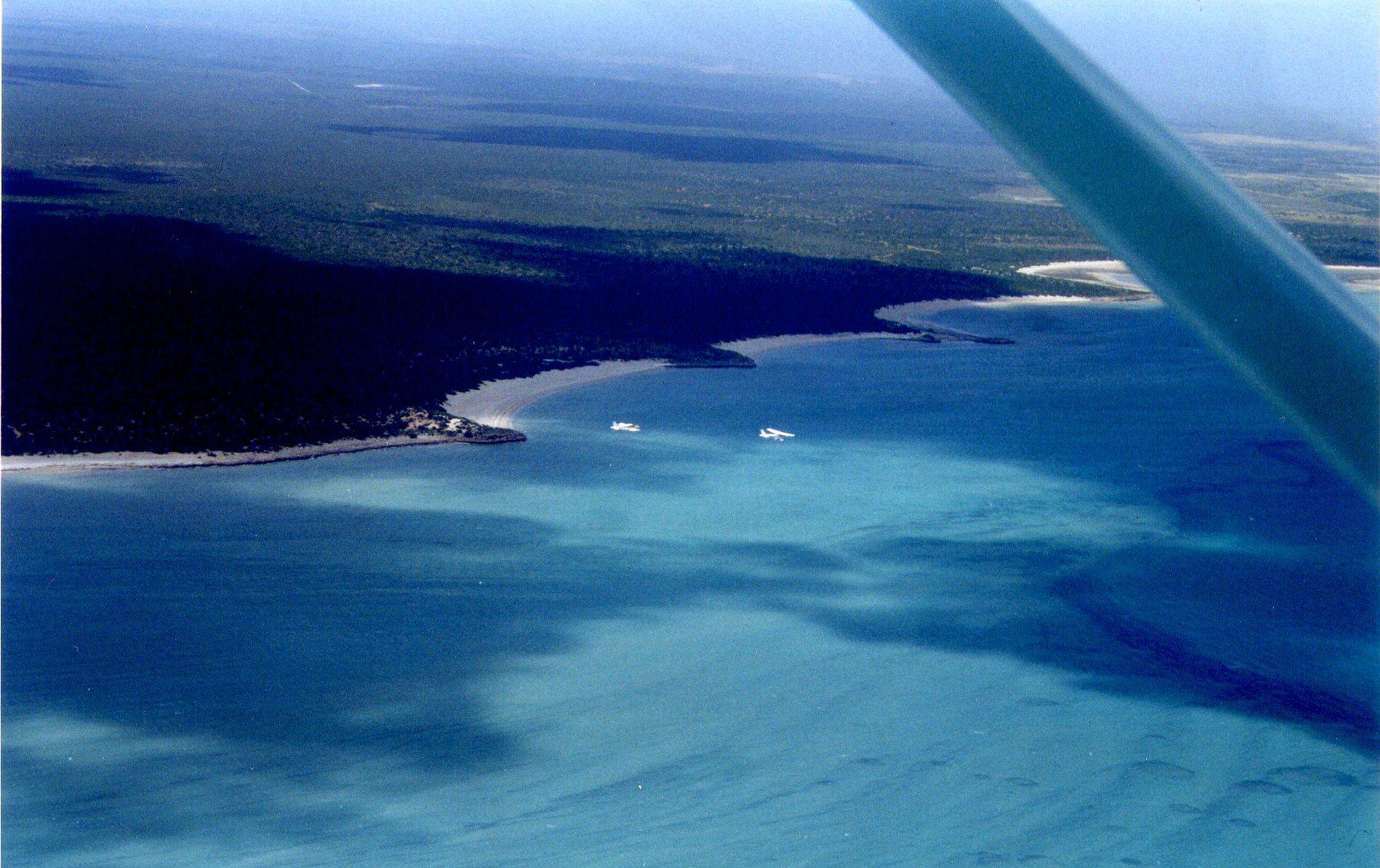 2 planes over the ocean.jpg