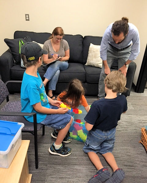 Kids have fun in the waiting room before the study begins, while parents sign a consent form.