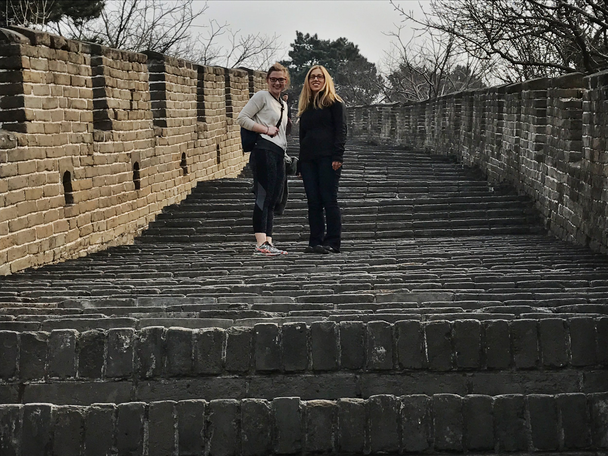Kimmy and Janet on the Great Wall. Look how steep those stairs are!