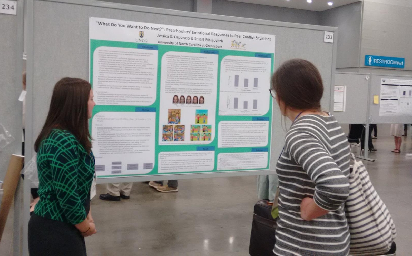 Jessica Caporaso talking to an interested colleague about the effect of children's emotions on peer interactions at SRCD 2017