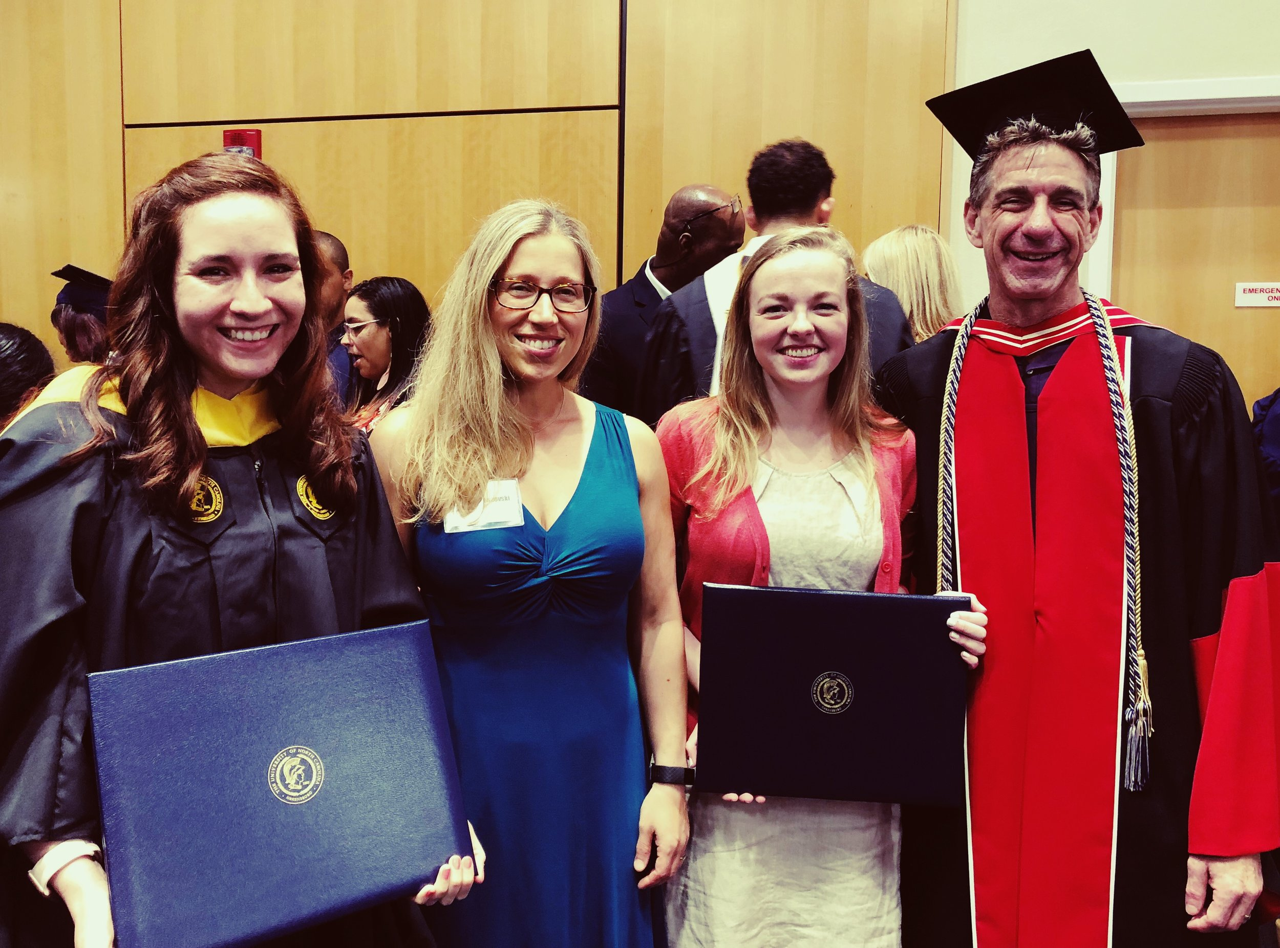 (from left to right) Andrea, Dr. Boseovski, Rachel, and Dr. Marcovitch at the Psychology Department graduation ceremony