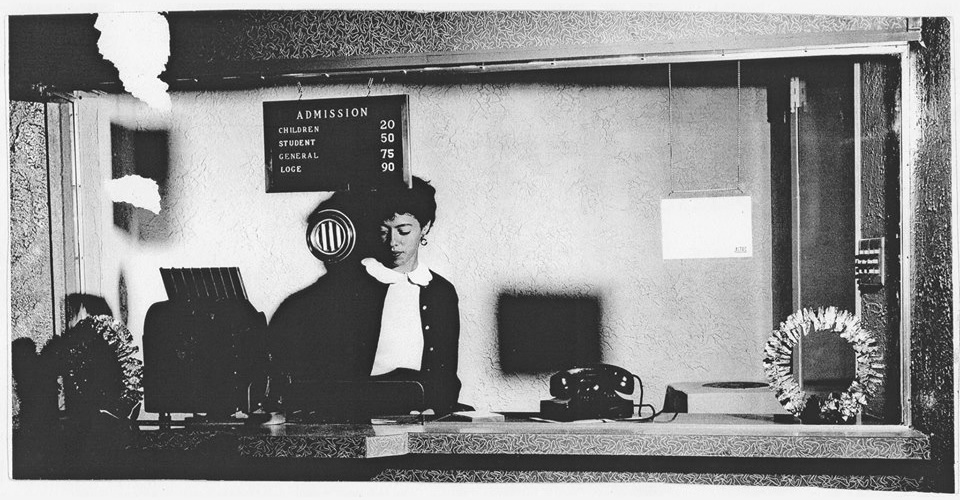 Frances Flores Goyer of Lompoc works in the ticket office of the original Lompoc Theater during the 1950s. Photo credit: Lompoc Valley Historical Society.