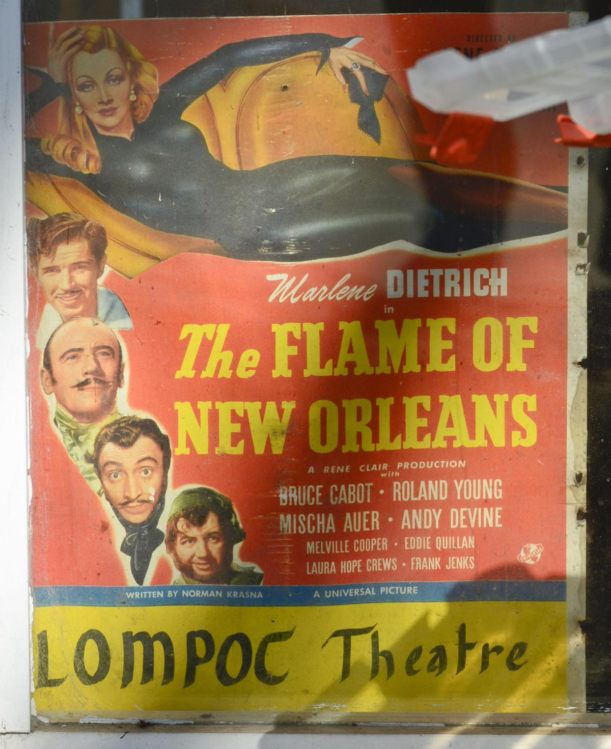 "An old movie poster advertising the 1941 movie ""The Flame Of New Orleans,"" starring Marlene Dietrich, was found inside a wall in an office at the Lompoc Theatre during renovation.  (Len Wood, Lompoc Record)"