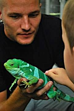 Showing off a Fijian banded iguana (B. bulabula) to my nephew at the San Diego Zoo.