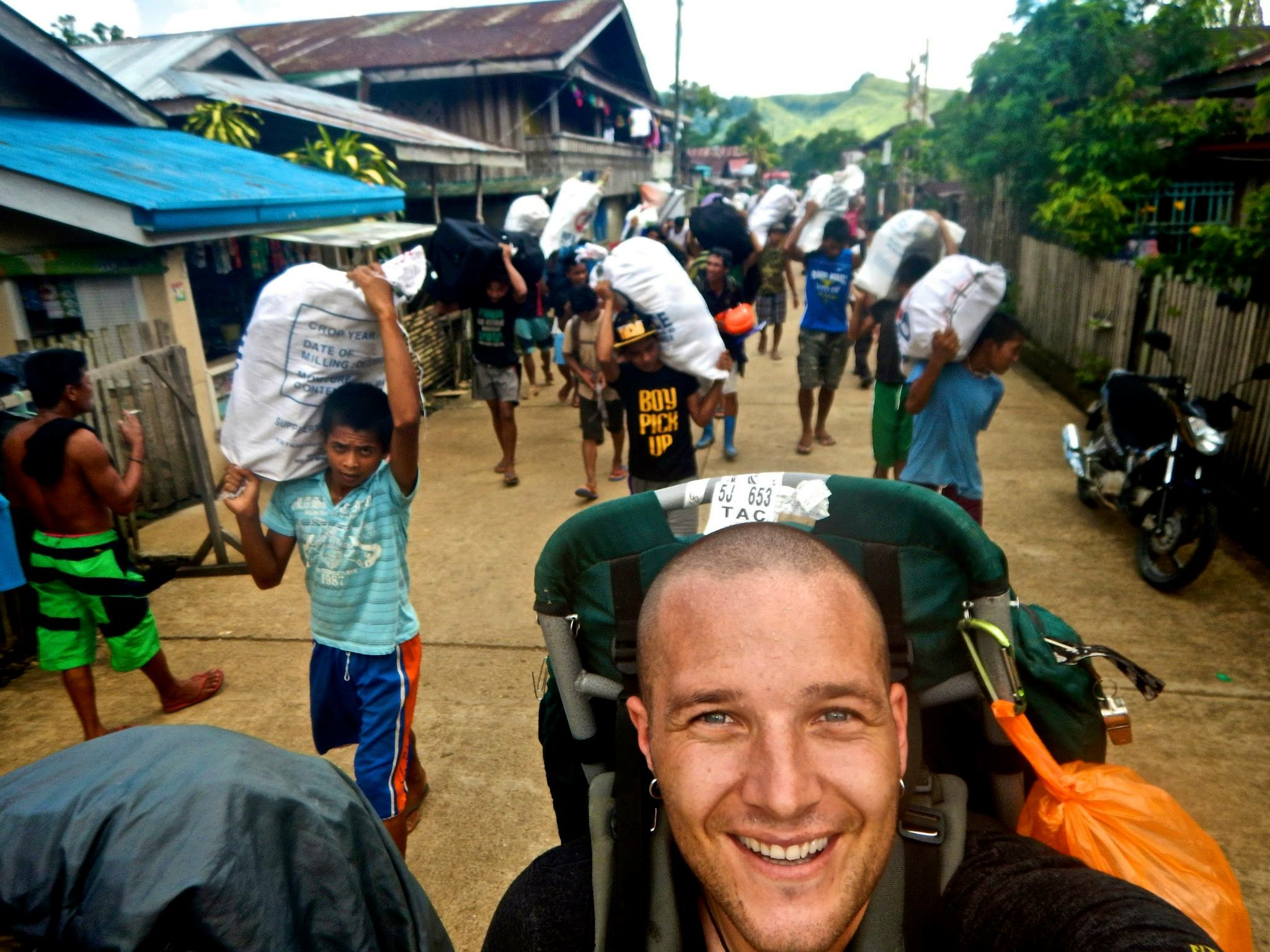 Heading up into the jungle with about 30 porters carrying all of our research equipment prior to a 4 week trip (2014)