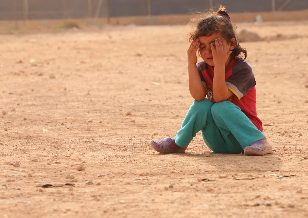 Syrian child refugee portrait crying girl