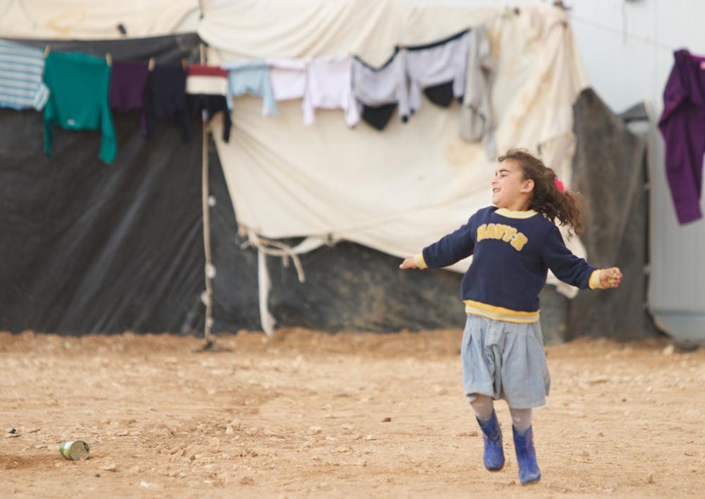 Syrian girl refugee playing