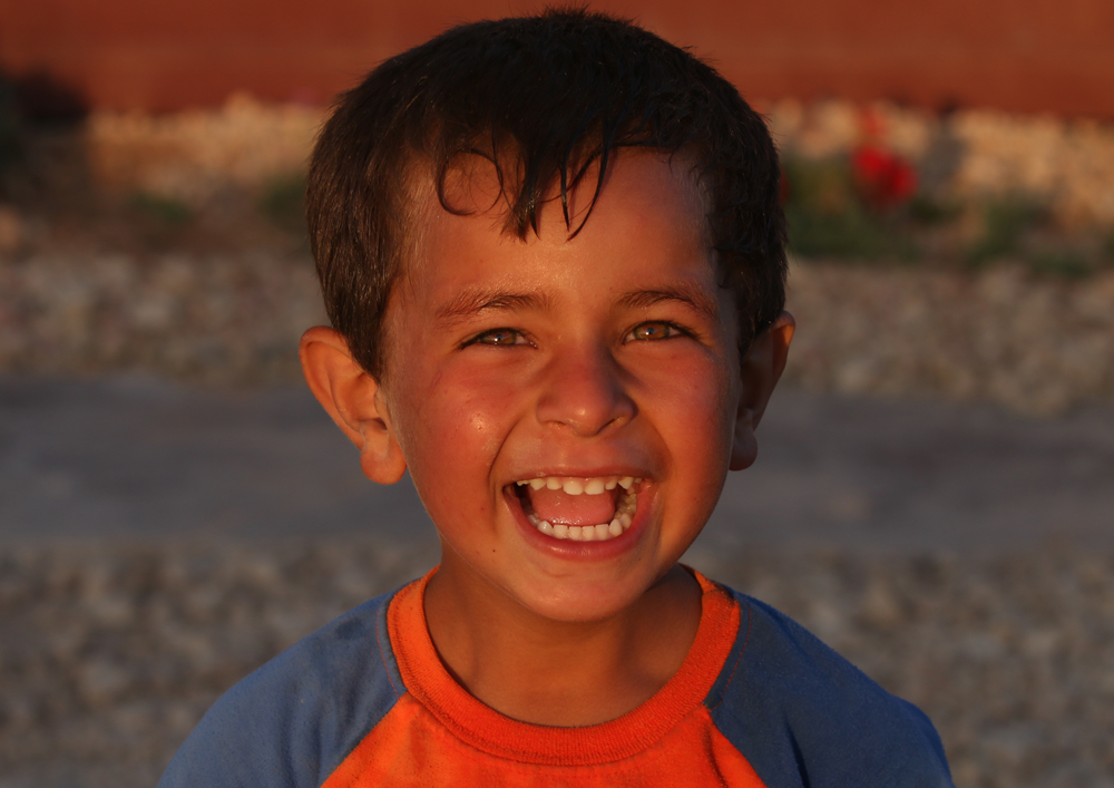 Syrian refugee smiling portrait