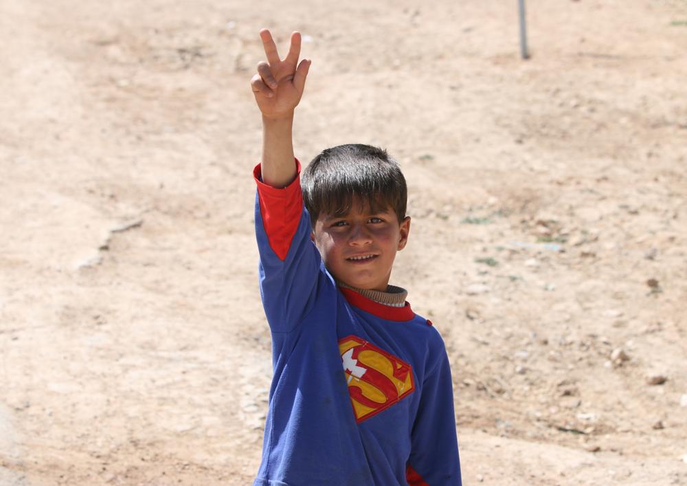 Syrian refugee child superman