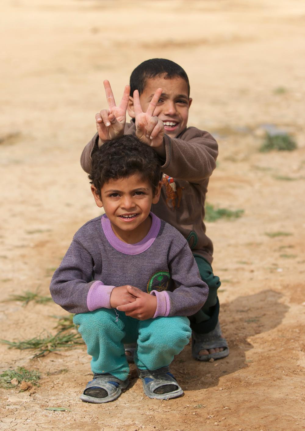 Syrian refugee children play