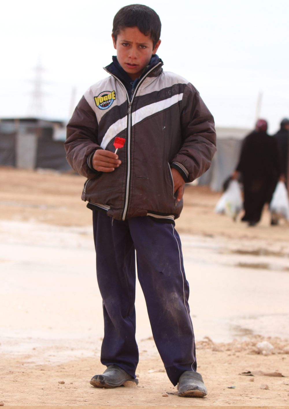 Syrian refugee boy with candy