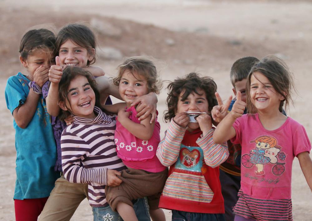 Refugee camp smiling children