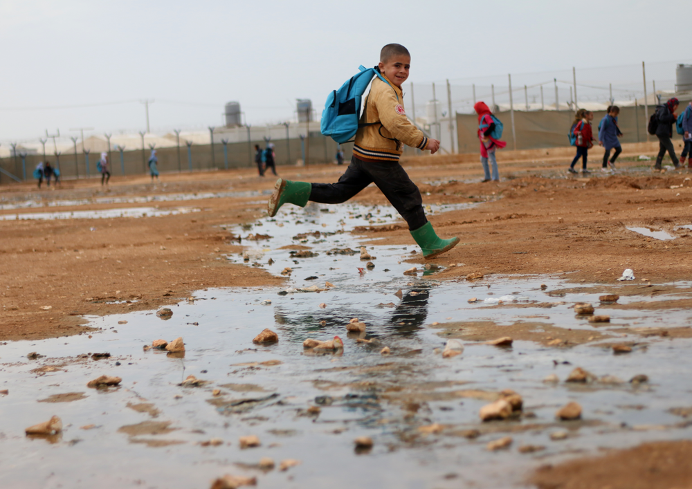 Syrian refugee child with backpack
