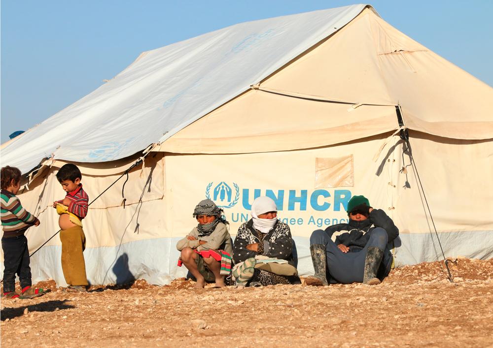 Syrian refugee camp family