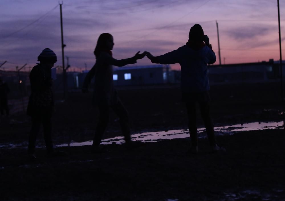 Syrian refugees at twilight Zaatari