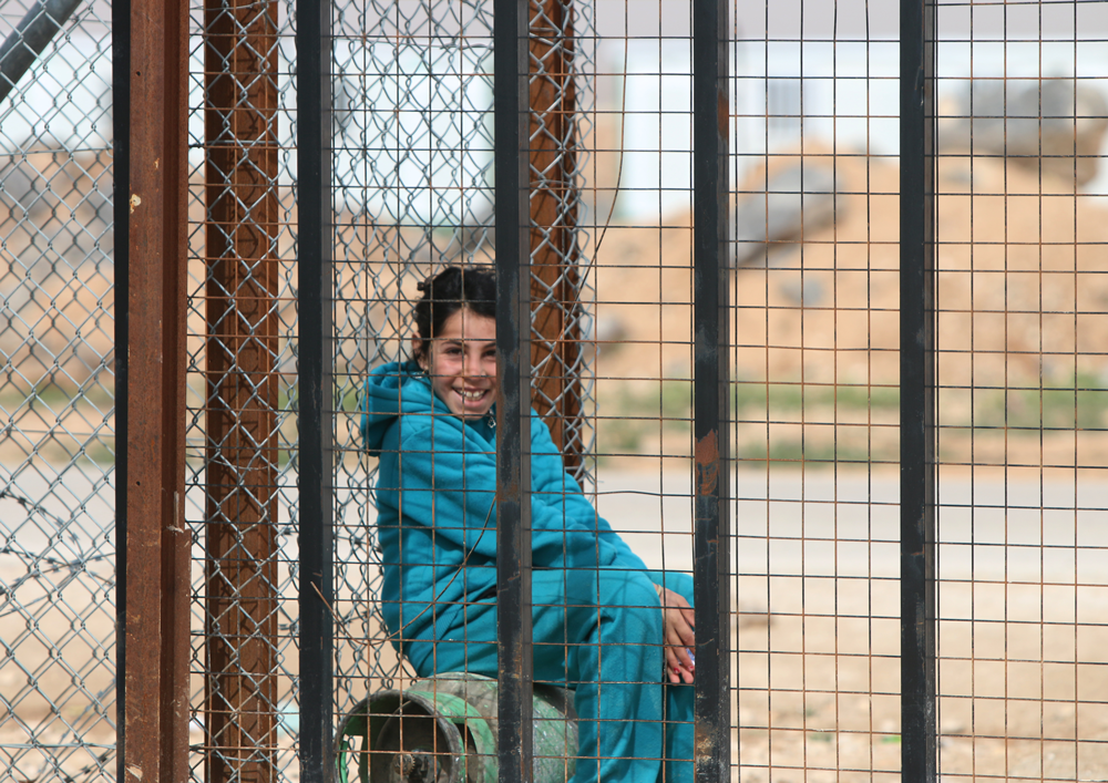 Syrian girl working refugee camp