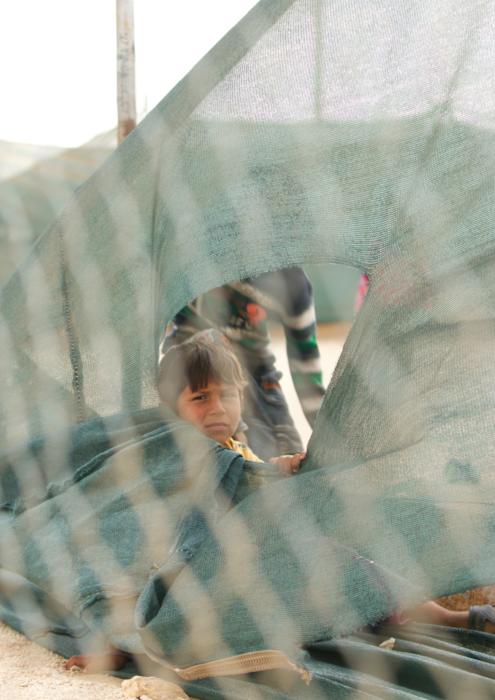 Portrait through fences at Syrian refugee camp