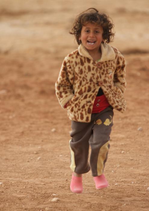 Syrian refugee child running