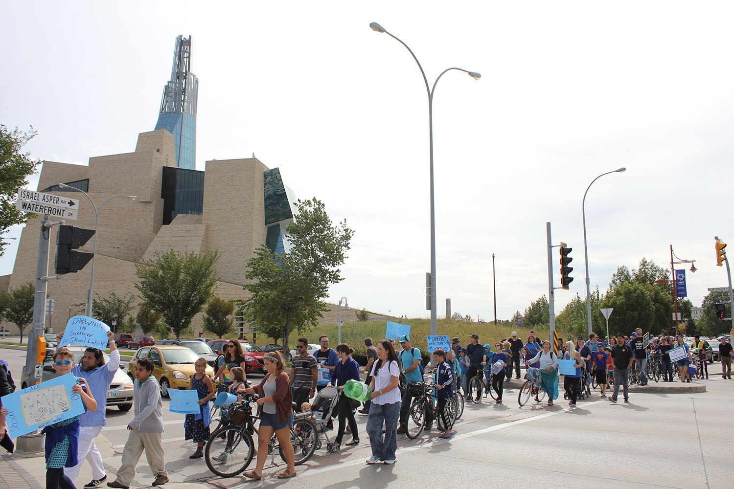 Winnipeggers marching in support of Shoal Lake and Freedom Road in front of the Canadian Museum of Human Rights, whose water comes from Shoal Lake.