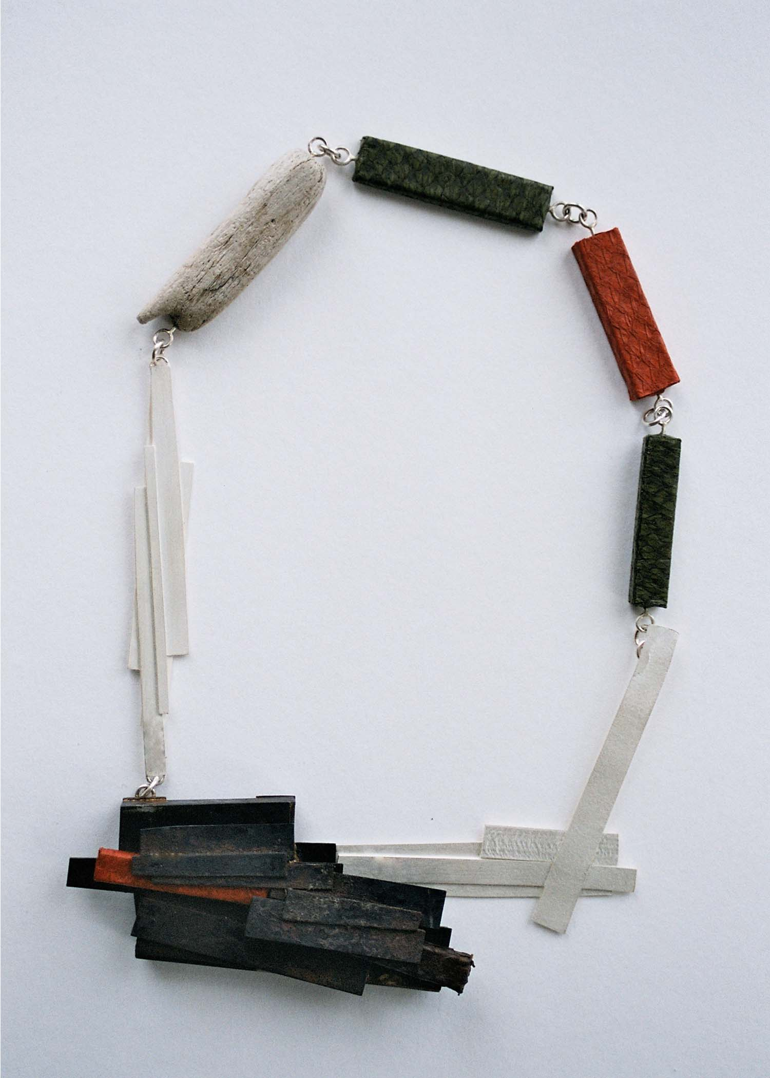 Steel necklace. Steel, sterling silver, fish skin, driftwood. 2007