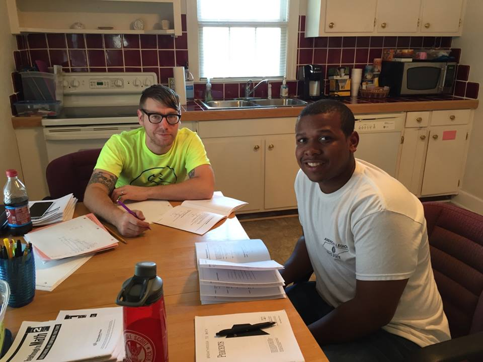 Brandon (in green) with tutor Michael Fox