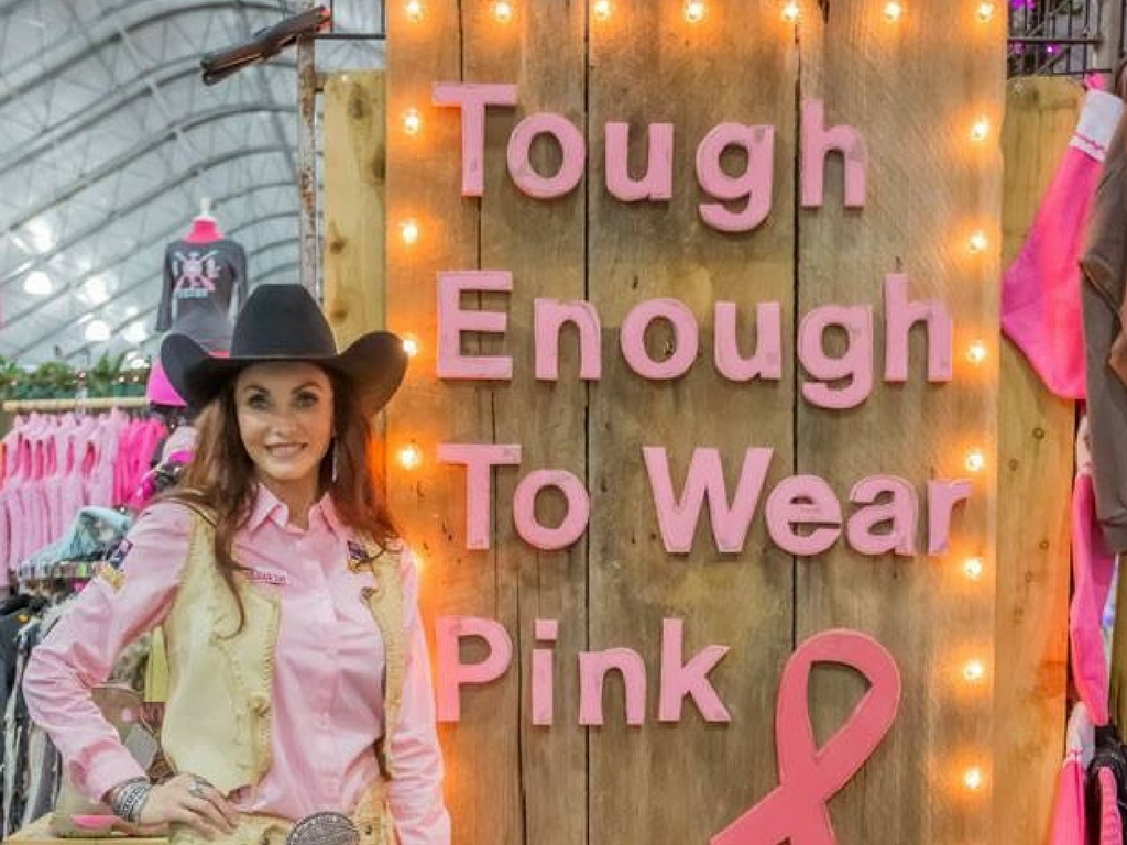 Ms. US Ambassador FoRe She's Gone Country w/the CB Cowgirls  at the  Tough Enough to Wear Pink  booth with Sharon Lockett. Dec 5th was @ Tough Enough to Wear  Pink day where they celebrated a BIG milestone with the 12th Annual Wrangler Tough Enough to Wear Pink Night at the Wrangler National Finals Rodeo-$25 million raised!!  Please stop by and help support this PHENOMENAL organization!!  She's Gone Country ,  Bill McRoberts ,  Bobbi Jeen Olson ,  WILD INSTINCTS ,  Western Trading Post ,  American Hat Company ,  Tres Rios Silver .  You can help raise Breast Cancer Awareness by supporting either your location organization or The Breast Cancer Research Organization that benefits from the funds raised at the National Finals Rodeo.    You can learn more at  www.toughenoughtowearpink.com