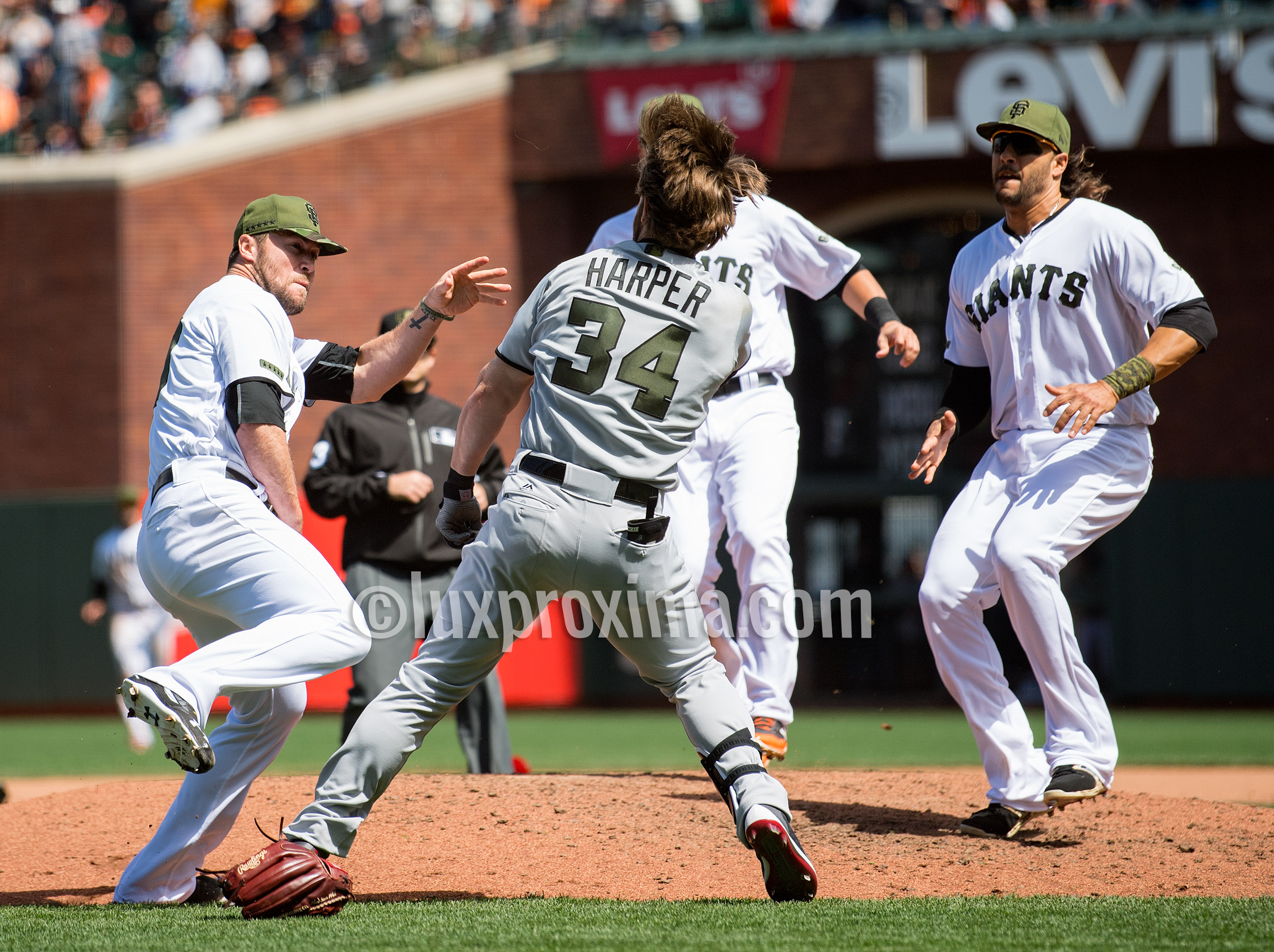 May 29, 2017: After being hit by a pitch, Washington Nationals right fielder Bryce Harper (34) approaches San Francisco Giants relief pitcher Hunter Strickland (60) on the mound. San Francisco Giants first baseman Michael Morse (38) and second baseman Joe Panik (12) (obscured) arrive to break up the fight that broke out during the eighth inning in a MLB baseball game between the Washington Nationals and the San Francisco Giants on Memorial Day at AT&T Park in San Francisco, California. Valerie Shoaps/CSM