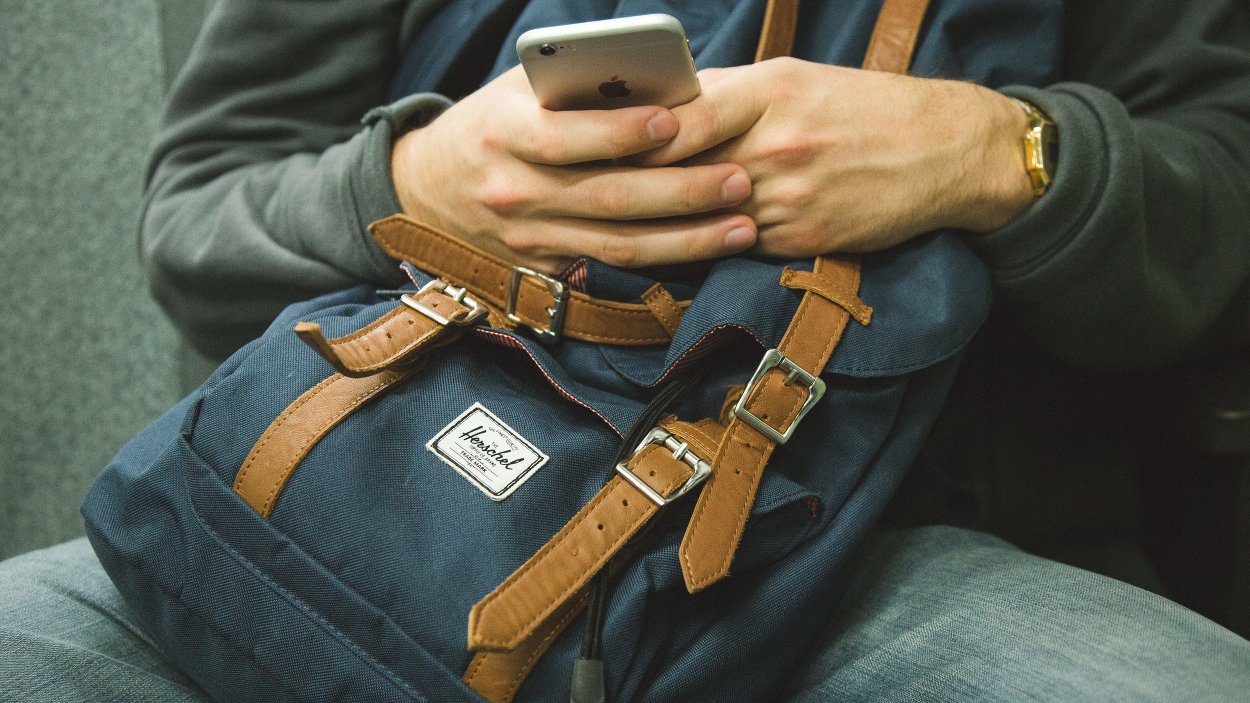 man with phone and bag.jpg