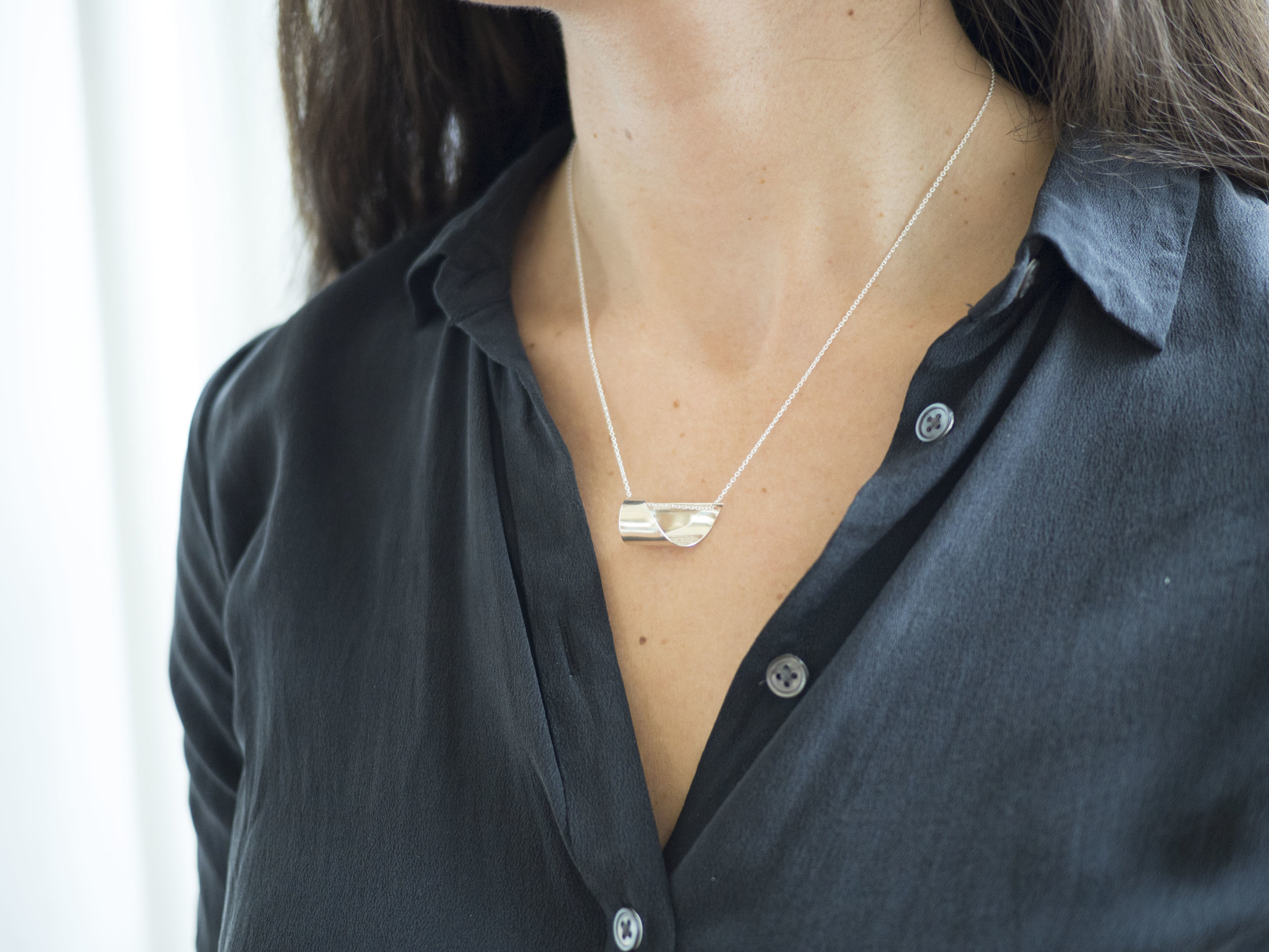 Sculptural design is smooth and comfortable to wear.