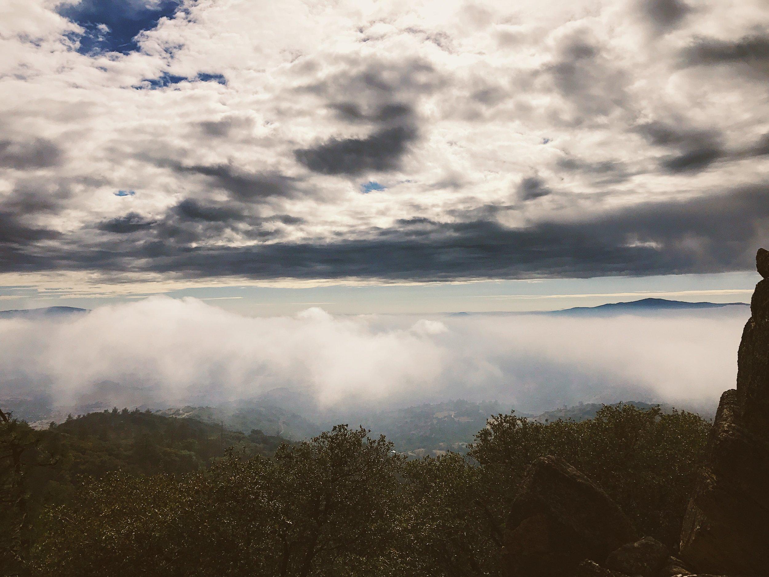 clouds above, fog below.