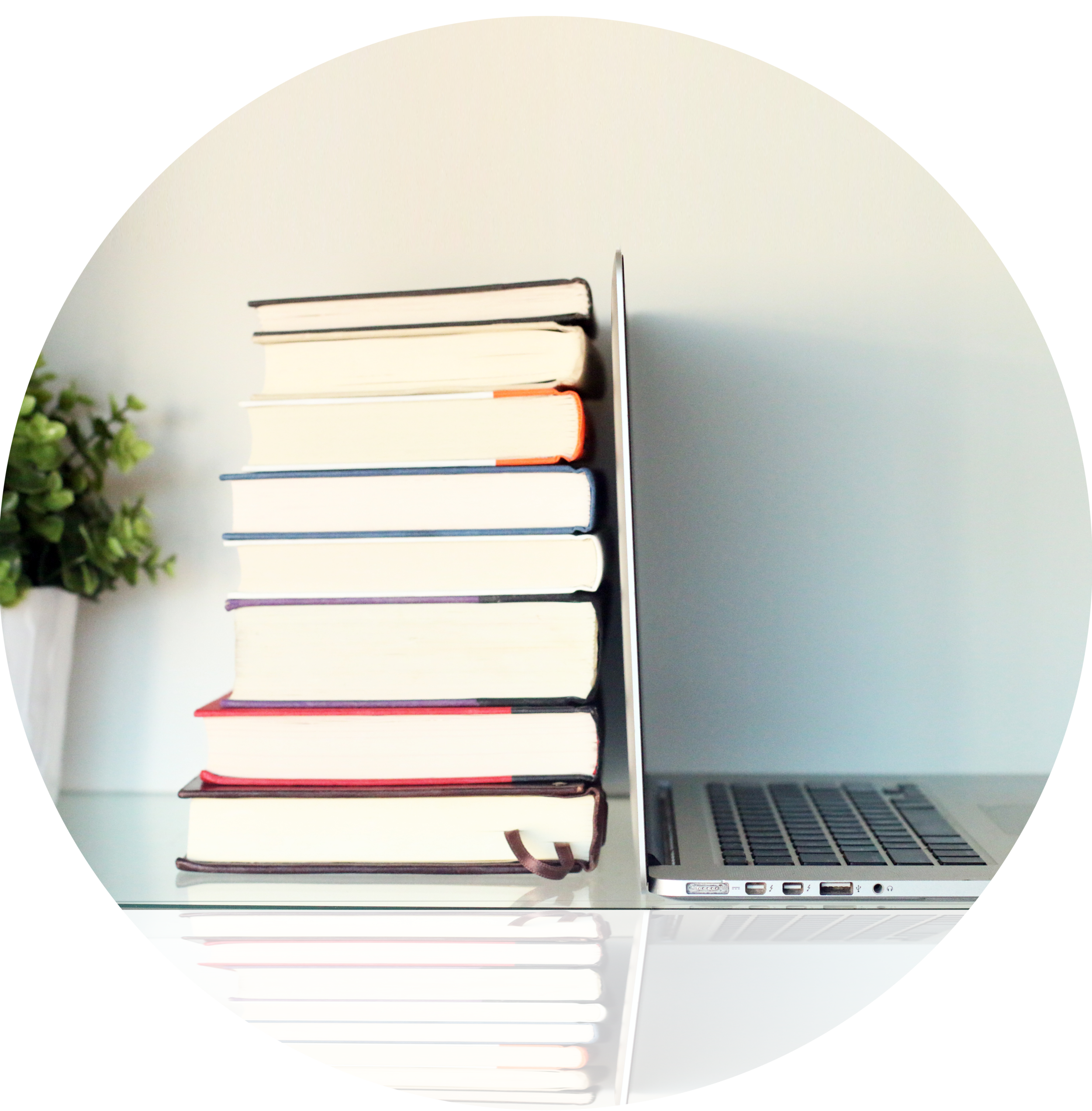 stock-photo-stack-of-books-and-laptop-on-wooden-table-370931219-1.jpg
