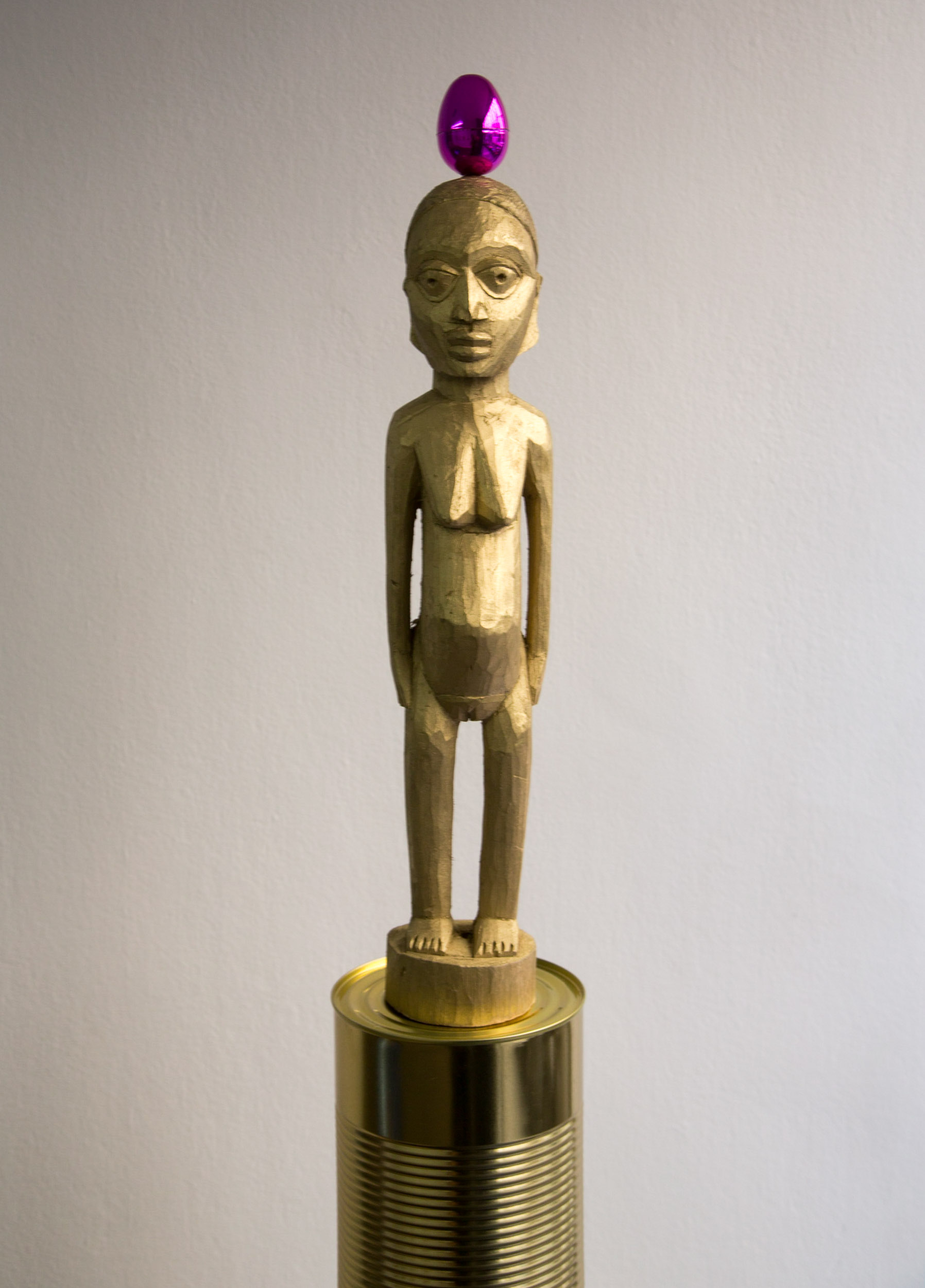 """Saint Selavy , 2014  Wood, metal, NFC tags Dim: 180 x 20 x 20 cm  The  Electrofetishes  series combines readymades, """"anti-folklorism"""", classical African art and spirituality.   Bocio , wooden statuettes mass-produced in Benin and Nigeria with the utilitarian purpose of being """"charged"""" during rituals are diverted, or rather """"reverted"""" by the intervention of the artist.  (click Next to continue)"""