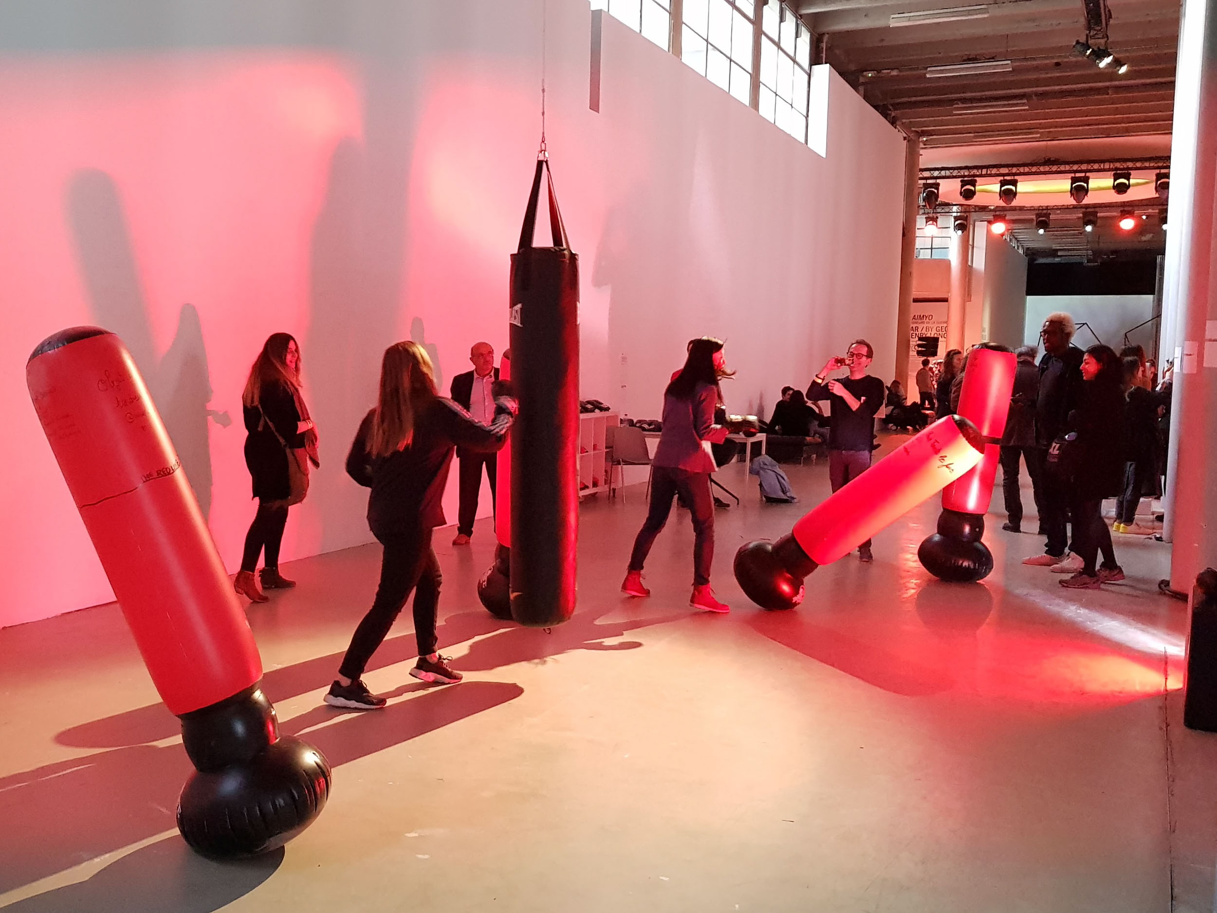 All photos from Do Disturb festival, Palais de Tokyo, Paris.     #MMF  , 2018   #MMF  is a performative and participative installation reflecting on the #metoo movement.  Its title is a compound of MLF (Mouvement de Libération des Femmes, the main French feminist movement of the 1970s) and MMA (Mixed Martial Arts).  A space is delineated by the installation of punching bags.  Boxing gloves and markers are provided to female visitors.  (click Next to continue)