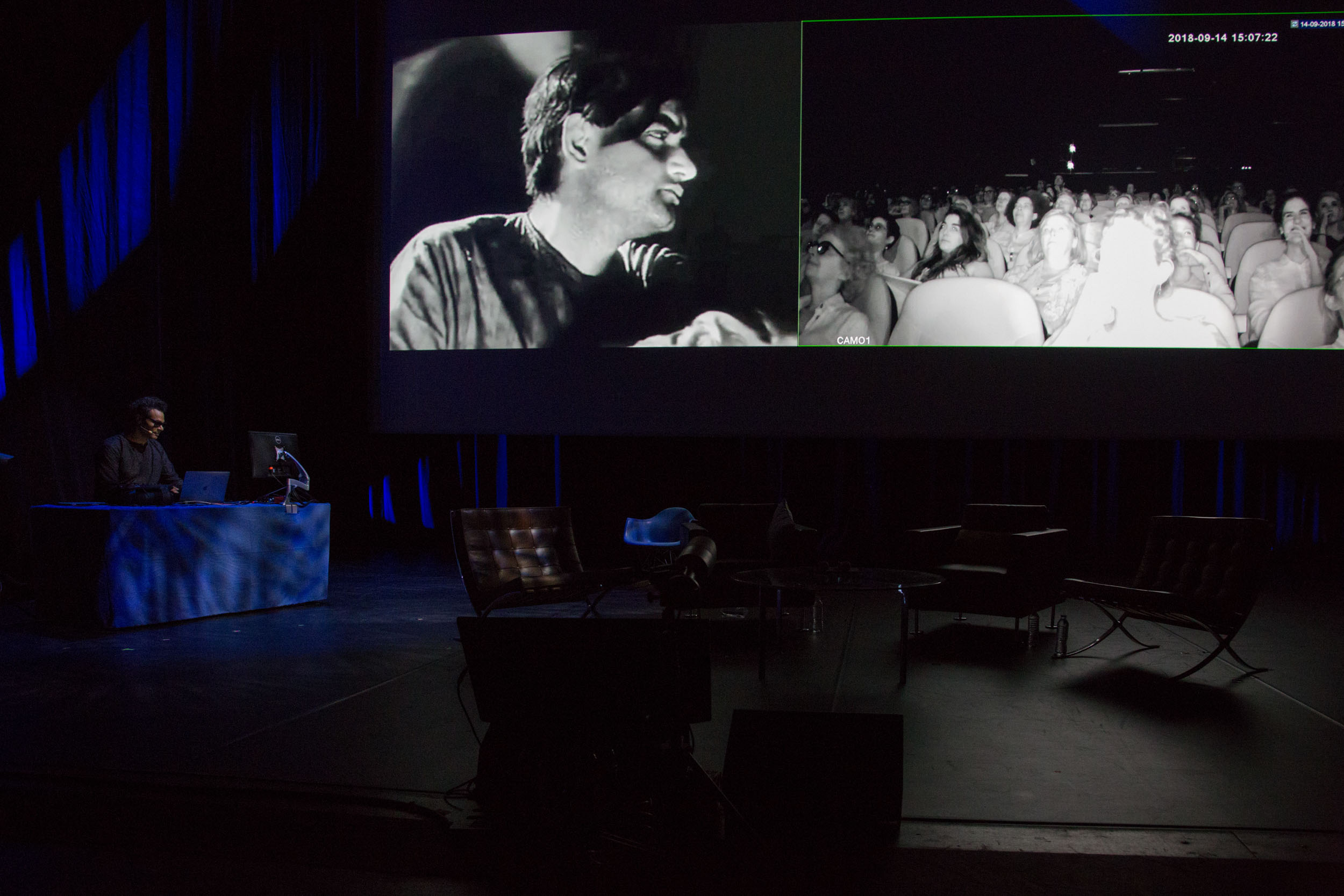 A music and video piece performed is played by the artist.  The video piece is composed of black and white silent films of various origins (Mexico, India, Japan, US) showing shots of characters showing intense emotions, and is displayed on the left half of the main screen in the performance space.  Eight video cameras capture the whole performance space, filming both the stage and the audience.  The cameras are switched to infrared mode so as to obtain a black and white image.  (click Next to read on)