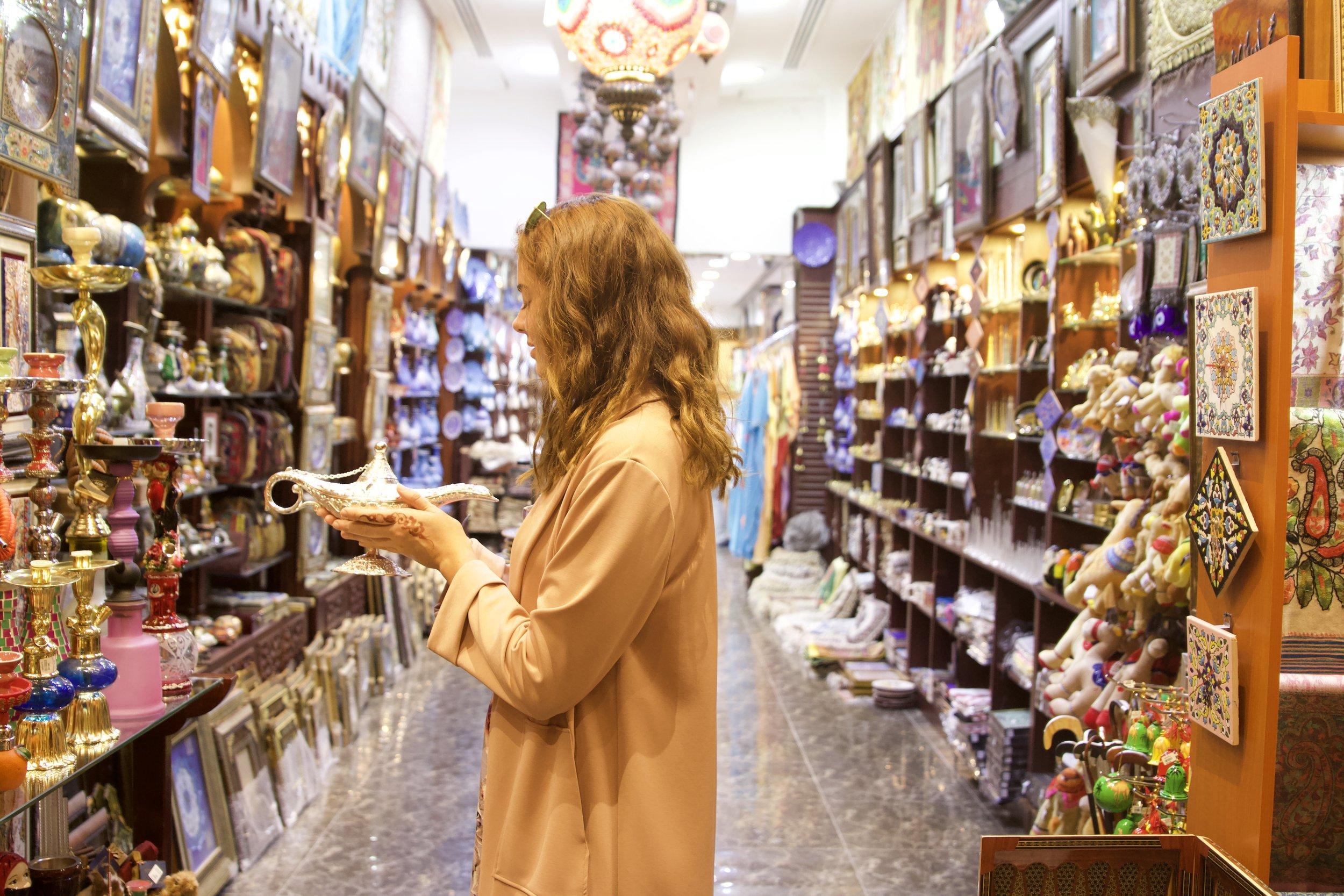 Eira making a wish at market store.